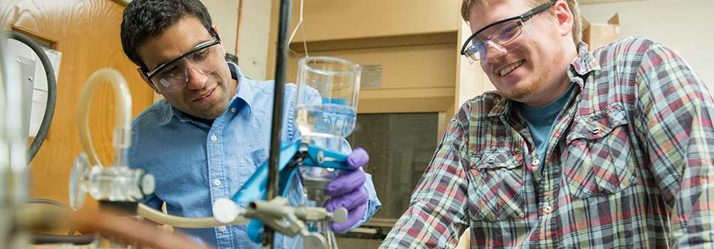 Penn State Hazleton faculty member working with a student in the chemistry lab.