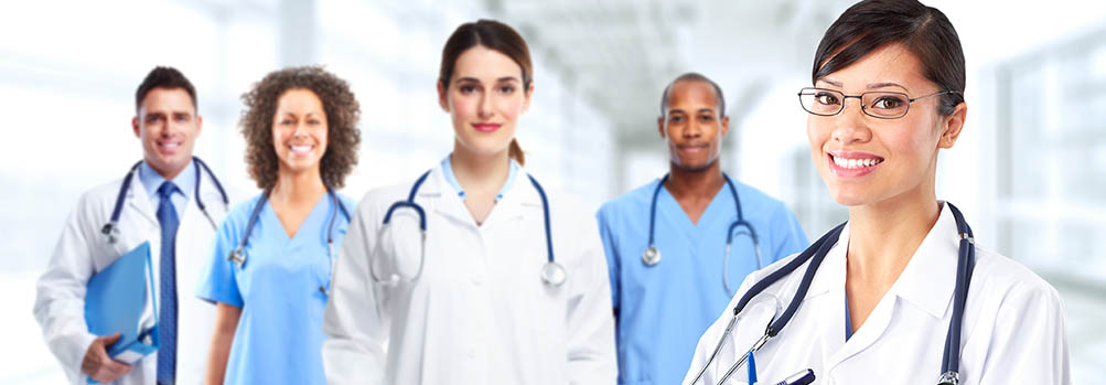 Five smiling male and female healthcare workers.
