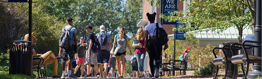 Students walking on the campus mall.