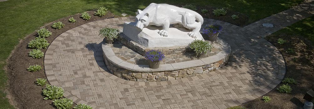 Nittany Lion statue with brick pathway