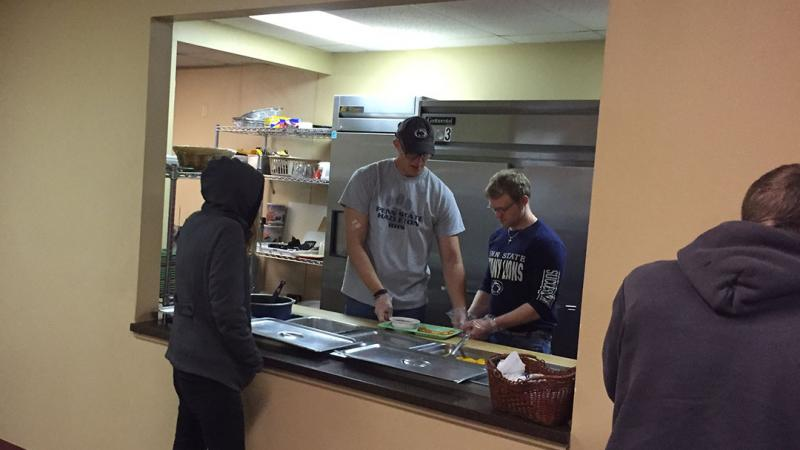 Rehabilitation and Human Services students work alongside Assistant Professor of Rehabilitation and Human Services Garrett Huck to serve lunch at the Salvation Army soup kitchen in downtown Hazleton.