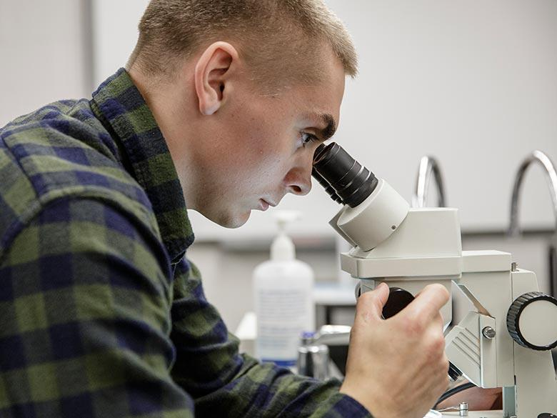A student using a microscope.