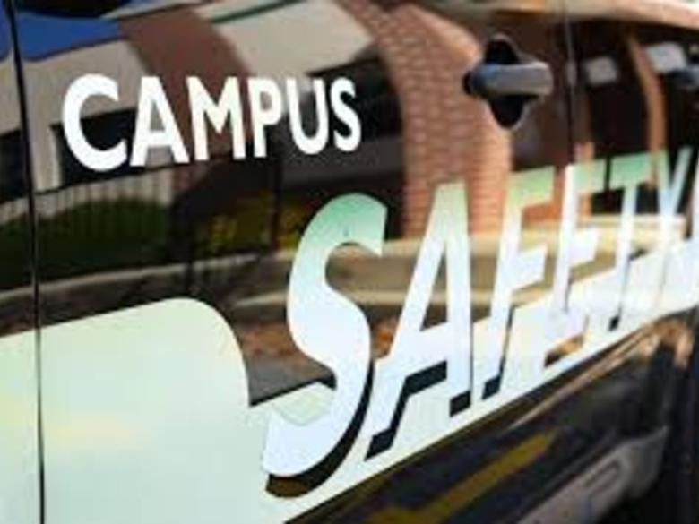 Side of campus safety vehicle with a reflection of a building.