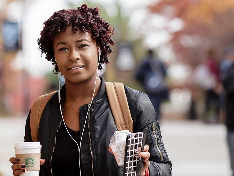 Woman student with coffee.