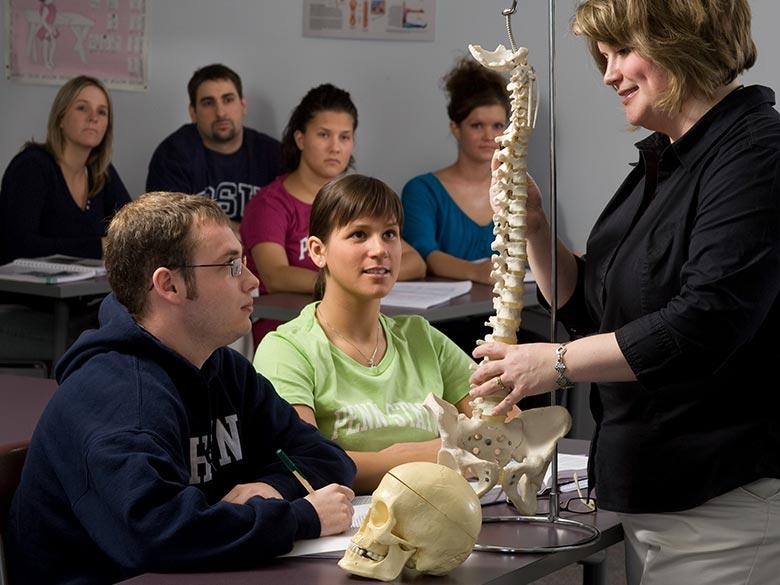Penn State Hazleton faculty member with skeleton teaching class.