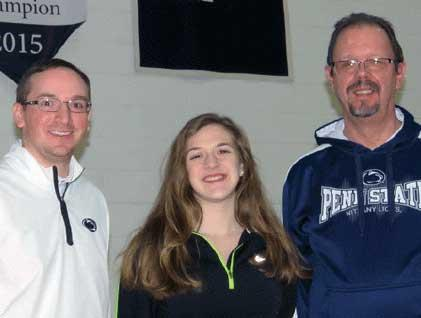 (Left to right) Dr. Ryan Ehrie Athletic Director, Katie Behnert, and Gary Lawler, Chancellor.