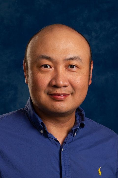 Professor Zugang (Leo) Liu with blue background