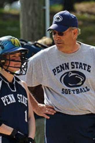 Marty Mrozinski is shown here coaching a softball team member.