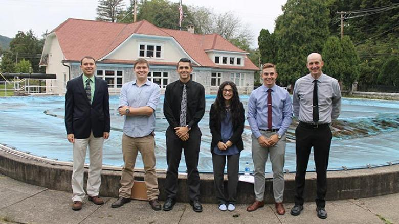 Assistant Professor of Engineering Joseph Ranalli, James Dotzel, Steven Principe, Cassandra Kelly, Justin Shimko and Assistant Professor of Engineering William Yourey stand in front of Bellefonte's historic Big Spring.