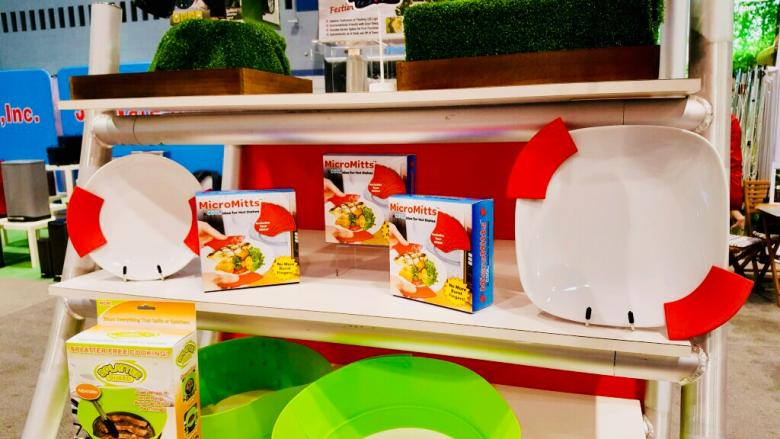"""Micro Mitts, on display at the International Housewares Trade Show in Chicago, was developed by Michael Paranich Jr., David Acker and Ramkumar """"Ram"""" Jayaveerapandian, who met at Penn State Hazleton."""