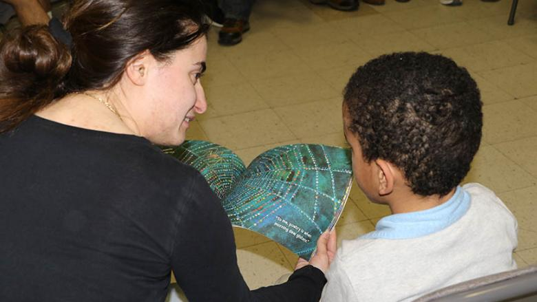 Veronica DiBlasi reads to a child in the Northeast Pennsylvania Migrant Education Program.